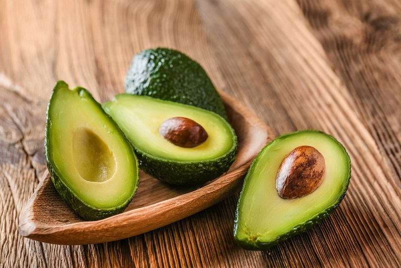 Avocado on old wooden table